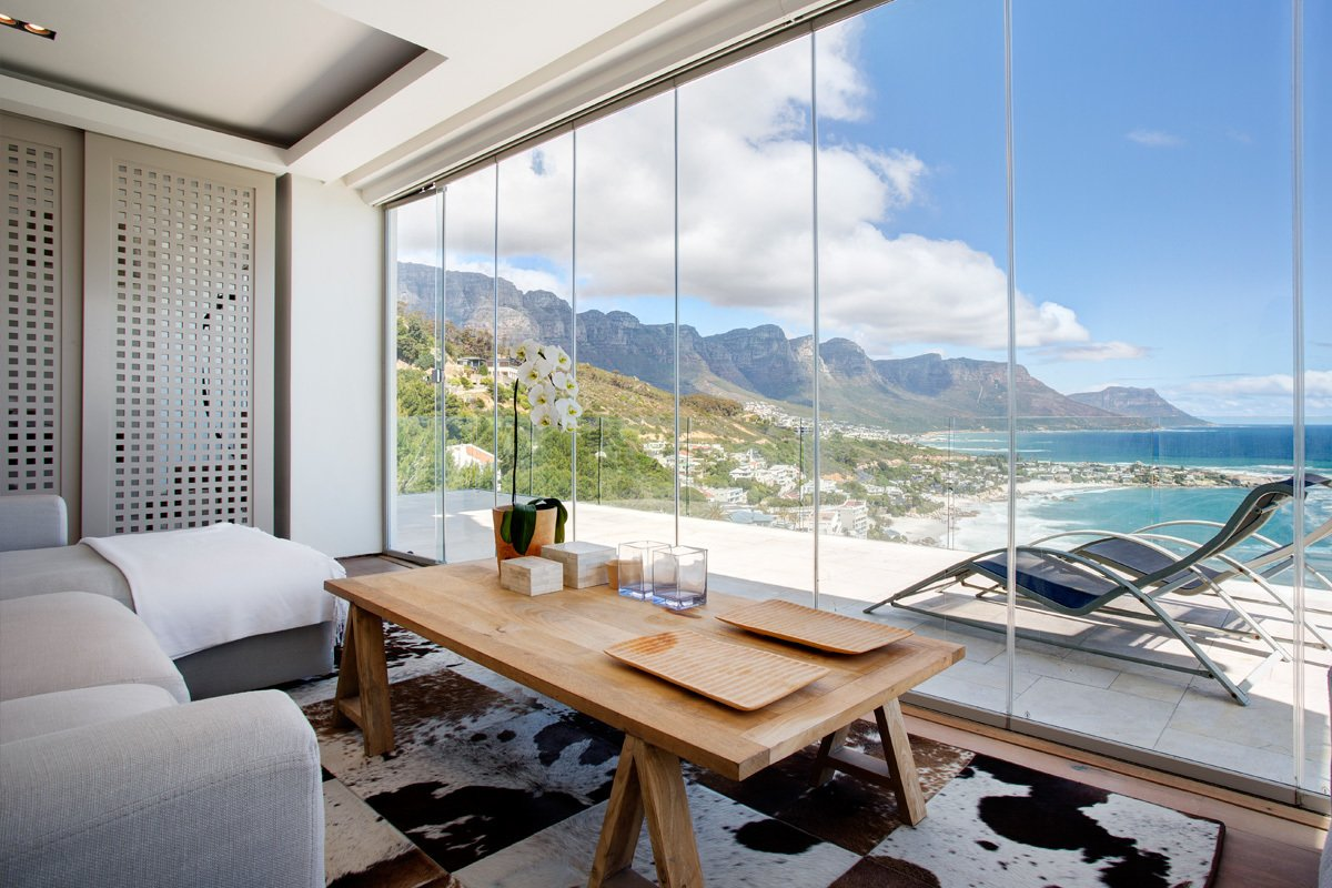 Looking out to unobstructed views of the Atlantic Ocean and Cape Town's rugged coastline, this cliff top resort has multi-room suites, as well as modern and elegantly furnished apartments that open to lovely views of the sea and the suburb of Clifton.  Photo 10 of 10 in 10 Cliffside Destinations That Will Make You Feel on Top of the World