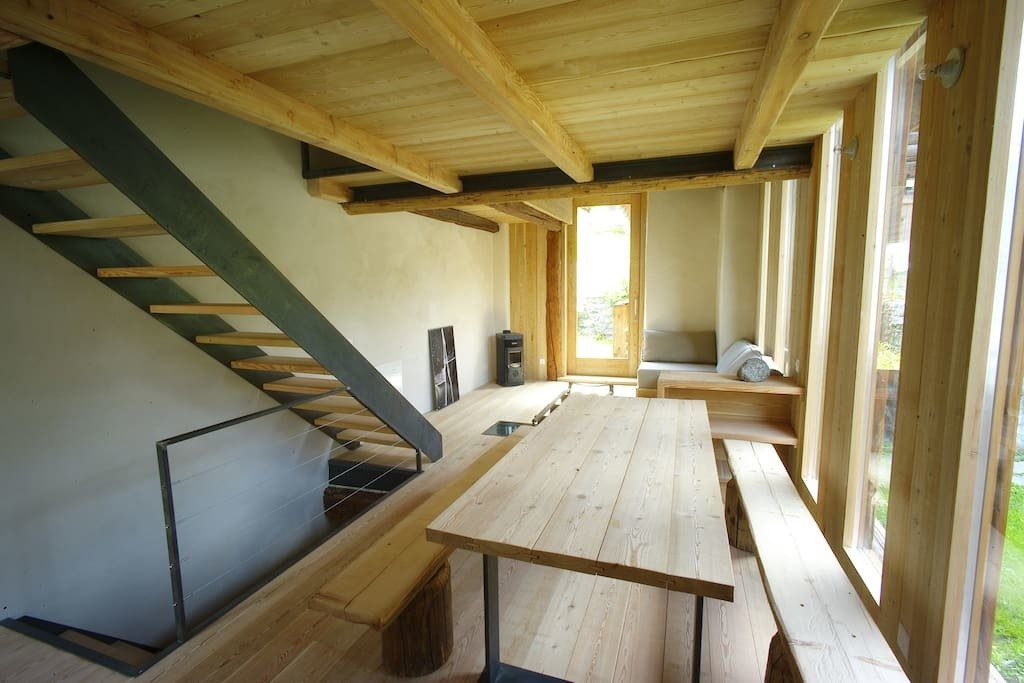 This 17th centry barn in the historic core of Bregaglia in Grigioni was renovated with Sisal – a natural fiber flooring of coconut and marsh grass, in the bedrooms.  Photo 7 of 8 in 7 Alpine Holiday Chalets in Switzerland