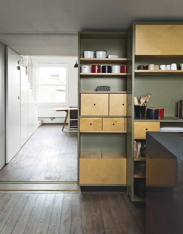 Storage Room, Cabinet Storage Type, and Shelves Storage Type Architects Silvia Ullmayer and Allan Sylvester helped reinvent metalworker Simone ten Hompel's 576-square-foot flat, with a retractable skylight and streamlined storage under the stairs.  Photo 7 of 9 in 8 Stylish London Apartments