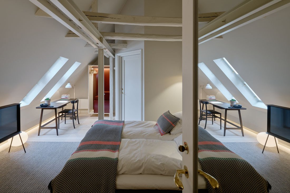 Bedroom and Bed Architecture and design firm Claesson Koivisto Rune transformed this Late Baroque villa into an 18-bedroom boutique hotel with painted wooden rafters and iconic mid-century furniture that's full of Nordic cool.  Photo 4 of 8 in 7 Stunning Scandinavian Hotels