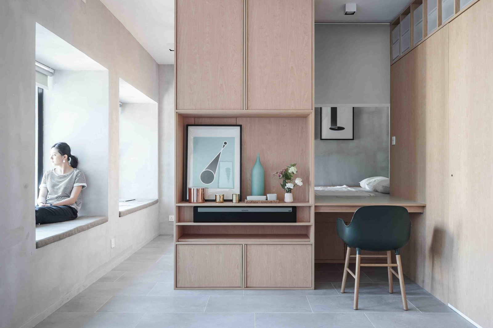 Office, Study Room Type, Chair, Desk, and Cement Tile Floor Feeling cooped up and stressed out? Here are some essential tips from designers and builders of small spaces.   Photo 4 of 11 in 10 Small Apartments by a Hong Kong Design Studio That Are Less Than 1,000 Square Feet