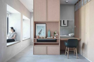 "Inspired by modern Japanese minimalism, the walls of this two bedroom apartment was demolished and the space transformed into a studio with an ""Engawa"" – a space  between the indoor and outdoor areas often found in traditional Japanese architecture – which maximizes light penetration into the interior. Kevin's home also has a working desk fitted with a retractable curtain for privacy."