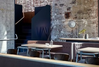 When this old power station in Melbourne was restored and transformed into a chic, six-level restaurant, the raw brick and concrete structure of the original building was preserved. The weathered look of the brick walls serve as a dramatic backdrop to the fashionable, contemporary furniture that inhabits the space.