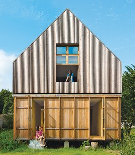 Designed by architecture firm Arba, this A-frame residence just 45-minutes outside of Paris has wood-stove heating, a solar vacuum tube for hot water, a washing machine, and a toilet that uses recycled water. Plus, it's connected to a 100-percent renewable grid that's supplied by French company Enercoop.