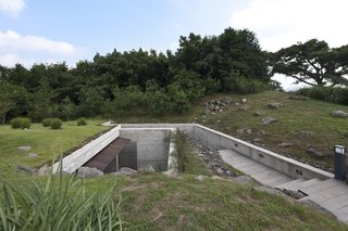 Also by Korean firm BCHO is Jedong Ranch, a house in Jeju Island in South Korean, with a long staircase that leads down to an underground meditation space.