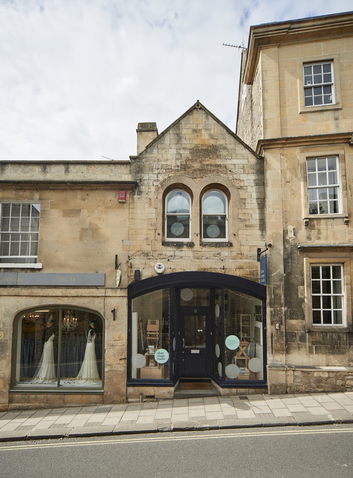 In the heart of the historic town of Wiltshire in Bradford-on-Avon is an apartment in a 19th century building that was refurbished by designed Ian Hill to combine a ground floor commercial space with a cozy first floor studio apartment with a stained glass window. Available for sale through The Modern House  Photo 7 of 8 in 6 Best Dwell UK Apartments