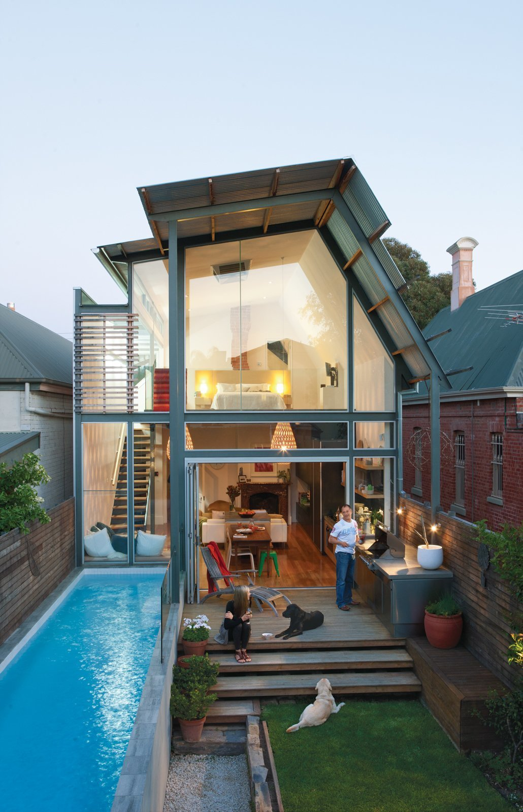 Outdoor, Raised Planters, Grass, Back Yard, Small, Wood, Small, Horizontal, and Wood The renovation and two-story extension of this 1880 Adelaide bungalow includes a 23-foot rear lot with a pool.  Best Outdoor Back Yard Wood Photos from 11 Amazing Australian Homes