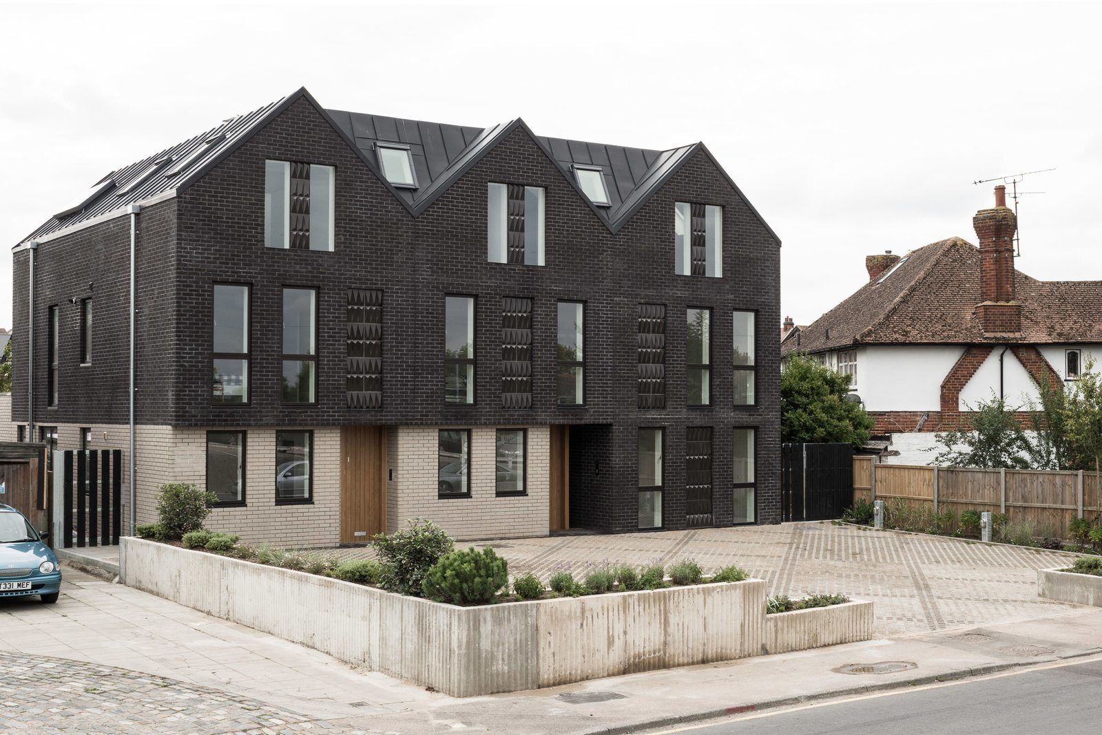 Located on the site of demolished old bungalows, Haddo Yard in Whitstable Kent now comprises of seven new-built apartments developed by Arrant Land and designed by celebrated UK practice Denizen Works. The building's facade has dark brick gables that echo the black timber sea front fishing huts in this part of Kent.  Photo 3 of 8 in 6 Best Dwell UK Apartments