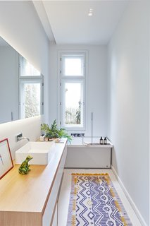 Designed by Hungarian studio POSITION Collective, this 2,099-square-foot, two-story villa on Rezeda Street in the Pest area of Budapest is home to a family of four. Within, herringbone wood floors, geometric details on the ceilings, quirky lighting, furniture with interesting textures and colors, and framed artwork and photography come together to create a jaw-dropping contemporary home.