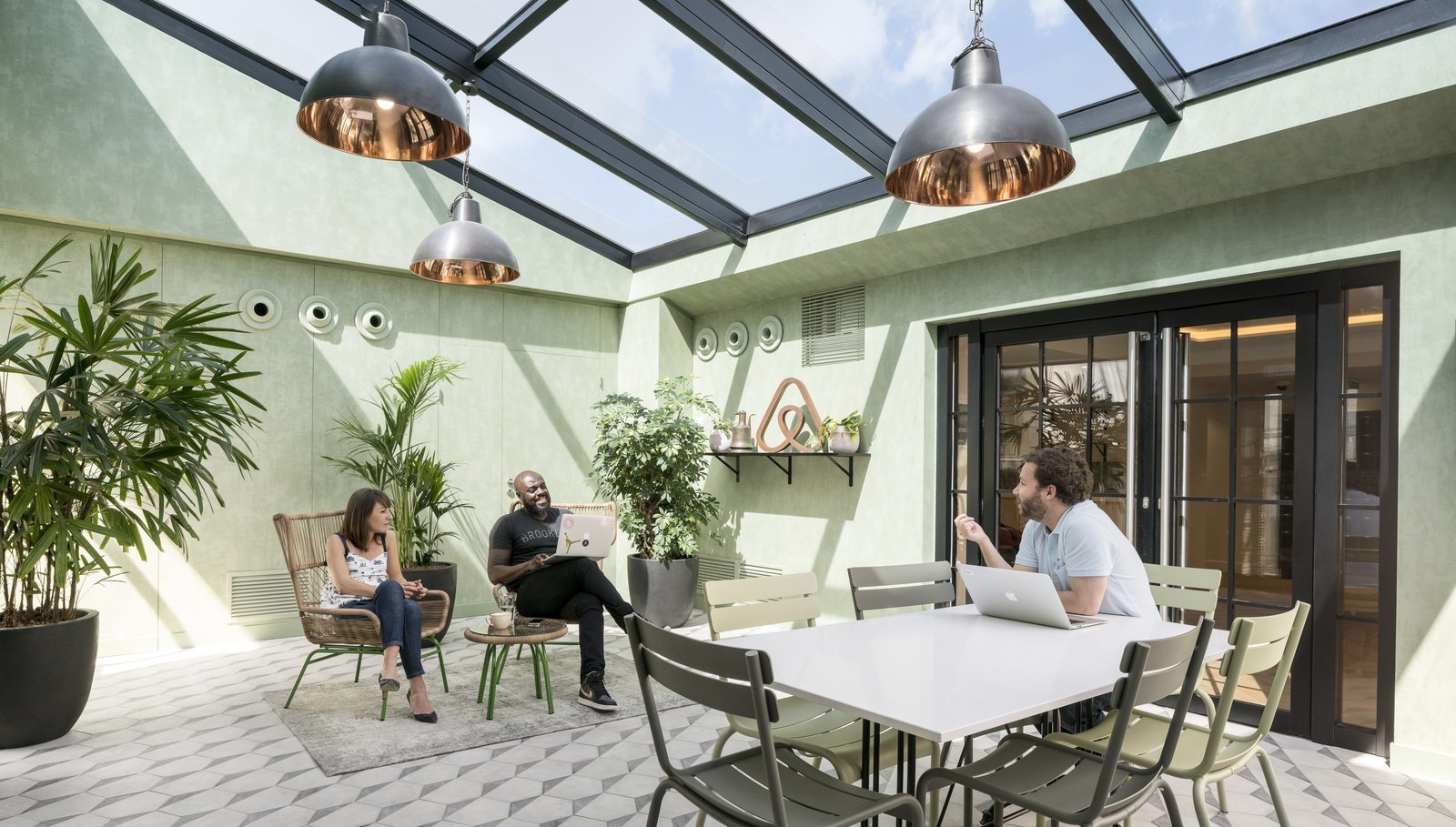 A company that knows the importance of feeling at home, Airbnb's Paris office was inspired by Paris attic lofts and includes a solarium and roof garden.  Photo 6 of 9 in 8 Modern Offices That Feel Like Homes