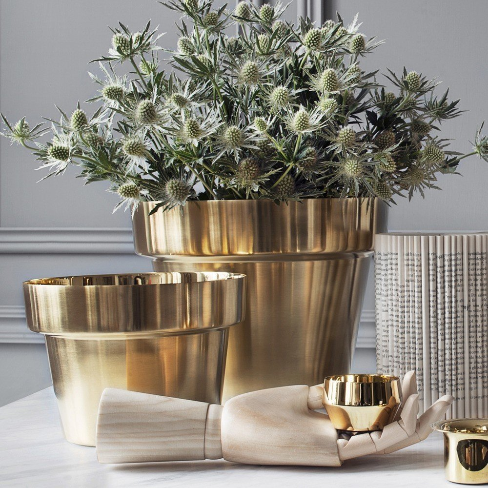 Copper or brass is a beautiful choice for contemporary interiors, and work particularly well for Scandinavian inspired concepts. Swedish designer Monica Förster's Brushed Brass Flower Pots elevates the traditional terracotta pots with luxurious brushed brass.  Photo 7 of 8 in 10 Unexpected Ways to Decorate With Flowers