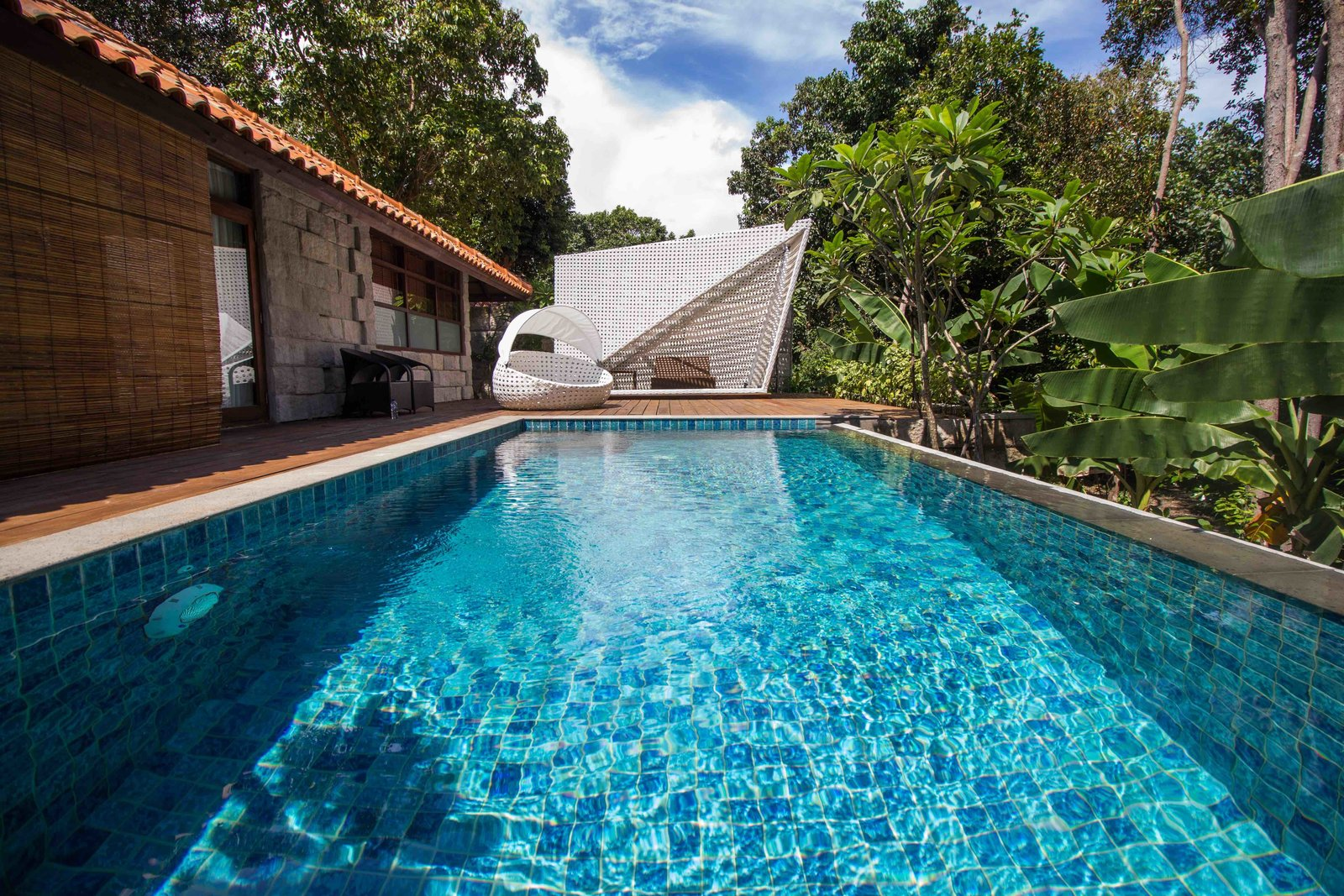Inspired by Indonesian arts and crafts, with a thoroughly modern fit out, this eco-friendly resort has two types, both with private pool, forest views and warm, earth-toned décor.  Photo 2 of 7 in 7 Incredible Island Villas in Indonesia