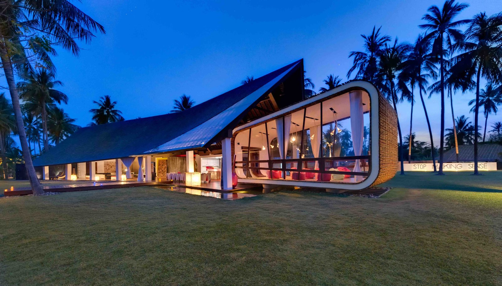 Designed by Canadian architect David Lombardi and set along an almost deserted beach in Lombok, this five bedroom modern architectural gem has a torch-lined timber pathway, and a guesthouse built into a grass covered manmade hill.  Photo 4 of 7 in 7 Incredible Island Villas in Indonesia
