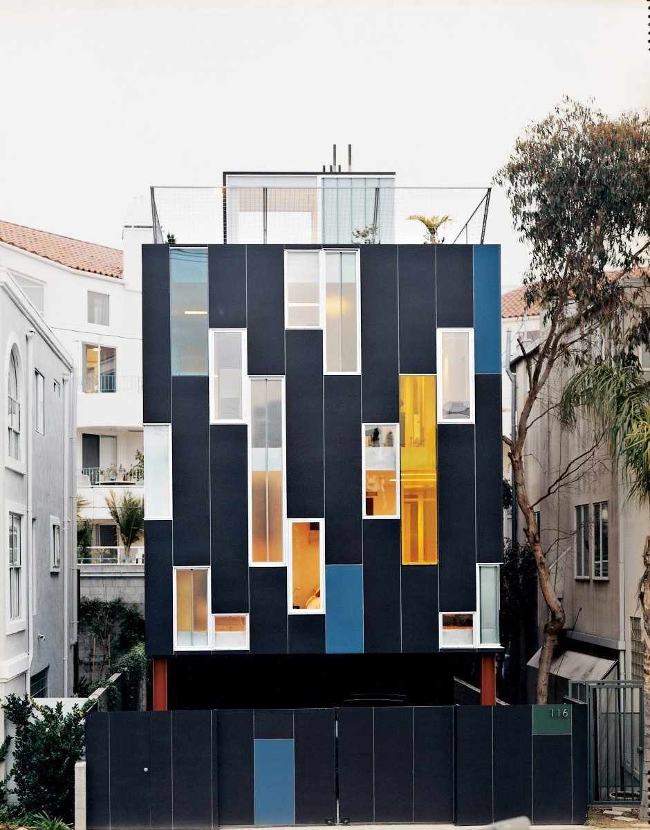 Front Yard, Exterior, Vertical Fences, Wall, and House Building Type Just off Pacific Avenue, architect Lorcan O'Herlihy designed this home for himself and his wife with a dark blue façade and dazzling display of colored window.  Photos from 10 Best Modern Homes in Venice Beach, California