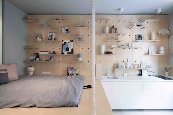 Budapest design studio POSITION Collective employs clever storage solutions, including a wardrobe rack, modular walls, and a storage-filled bed, in order to maximize functional space.  Though the 323-square-foot studio is now being leased out on a long-term basis, the clients had originally wanted to turn the small apartment into a stylish and memorable space for design-loving travelers visiting Budapest.
