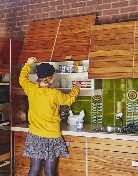 This 40 year-old mahogany-paneled Poggenpohl kitchen system was salvaged in a quirky 70s London home. Poggenpohl is the world's oldest kitchen brand, and this model comes with pocket doors that slide up to reveal drink ware shelves.