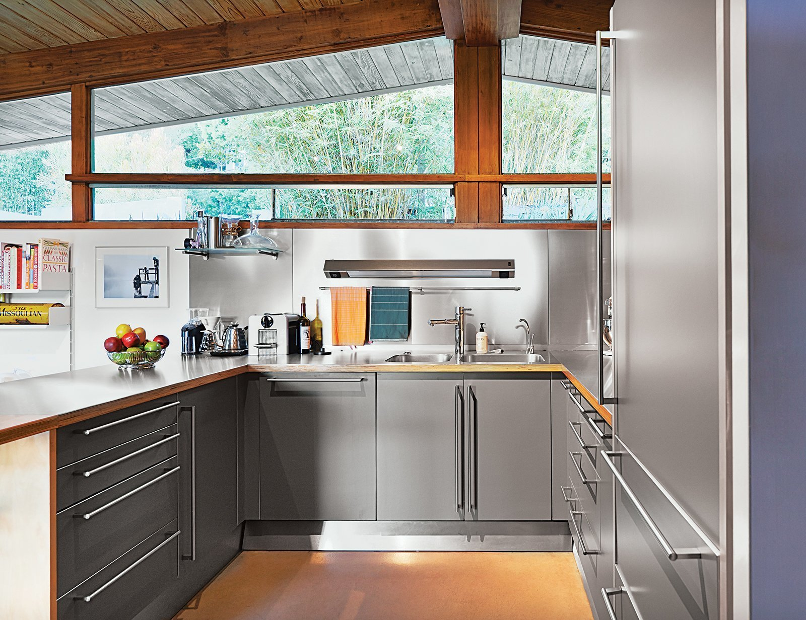 Kitchen, Wood Counter, Metal Cabinet, Metal Backsplashe, And Drop In Sink  Stainless