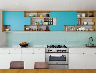 In this Palm Springs duplex, for cabinet doors, the architect owner designed aqua blue plywood sliders that park at specific positions, fitting together like puzzle pieces. Contractor Franklin Pineda custom-built these cabinets using Baltic birch plywood from Anderson Plywood.