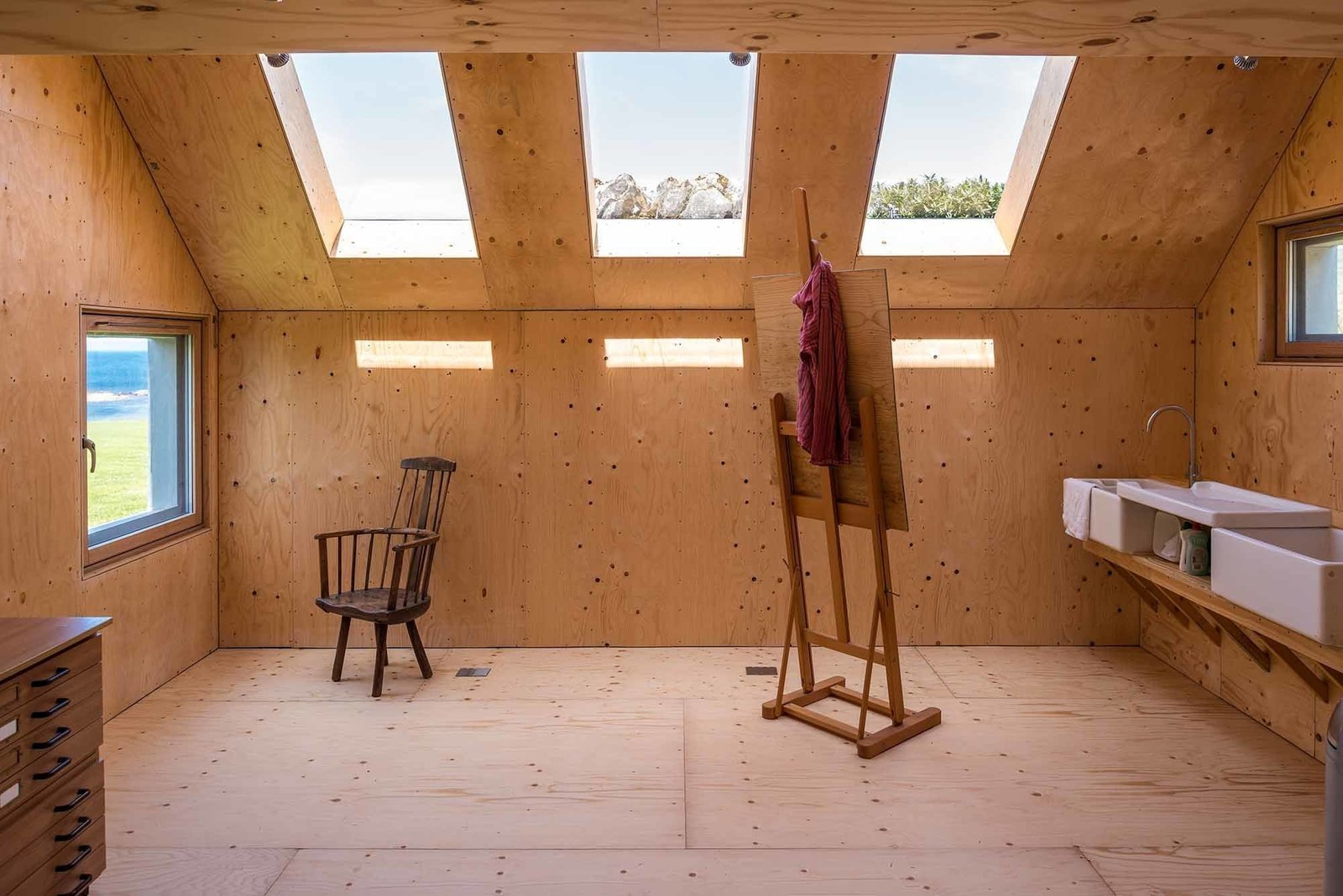 Shed & Studio, Living Room, and Living Space Interior of Midden Studio in Scotland.  Shed & Studio Living Room Photos from 10 Prefabricated or Modular Structures That Use Plywood in Creative Ways