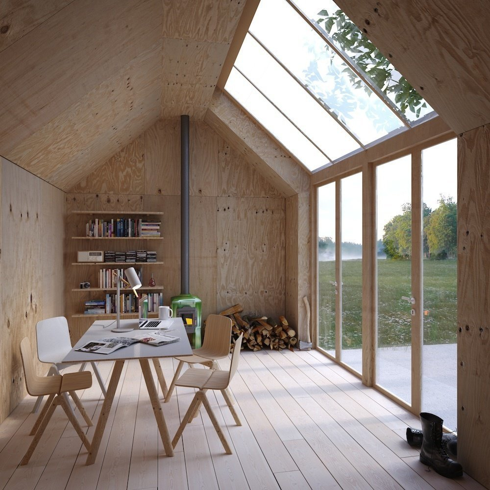 Shed & Studio, Living Space, Living Room, and Family Room Designed by Stockholm firm Waldemarson Berglund Arkitekter, this prefab artist studio called Ateljé 25 is shaped like a Monopoly house, serves as an artist's studio and has simple plywood interiors and massive skylights.  Shed & Studio Family Room Photos from 10 Prefabricated or Modular Structures That Use Plywood in Creative Ways