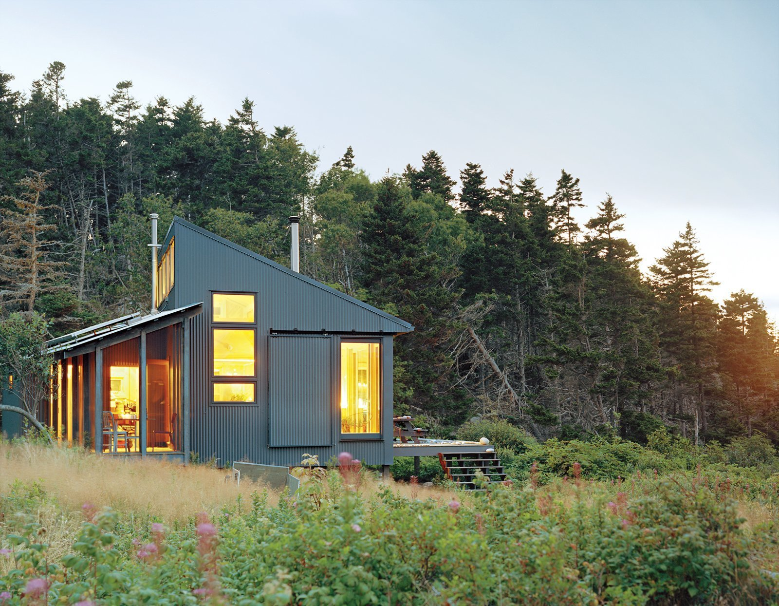 Exterior, Cabin Building Type, Metal Siding Material, and Metal Roof Material Writer and journalist Bruce Porter's off grid getaway on an island off the Maine coast, was designed by his architect daughter, who is the founder of her own practice Alex Scott Porter Design. Sited close to the water it has a screen porch was angled to capture direct southern exposure for the solar panels.  Photo 4 of 9 in 8 Tiny Sheds and Studios Used as Home Offices or Creative Retreats