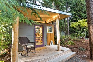 This prefabricated studio shed by Modern-Shed Inc. in Vahon Island, Washington, serves as a peaceful creative workspace for a professional artist.