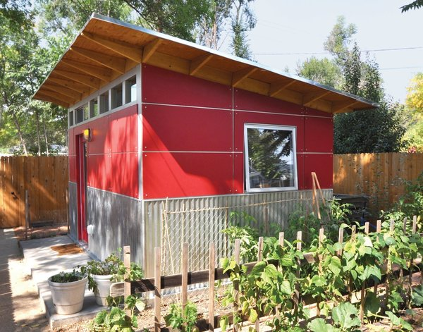 When a Colorado web designer's newborn daughter moved into his home office, he relocated to this cool shed made of ruby-red Collins Truwood Siding and corrugated metal, just a few feet from the back door of his house.