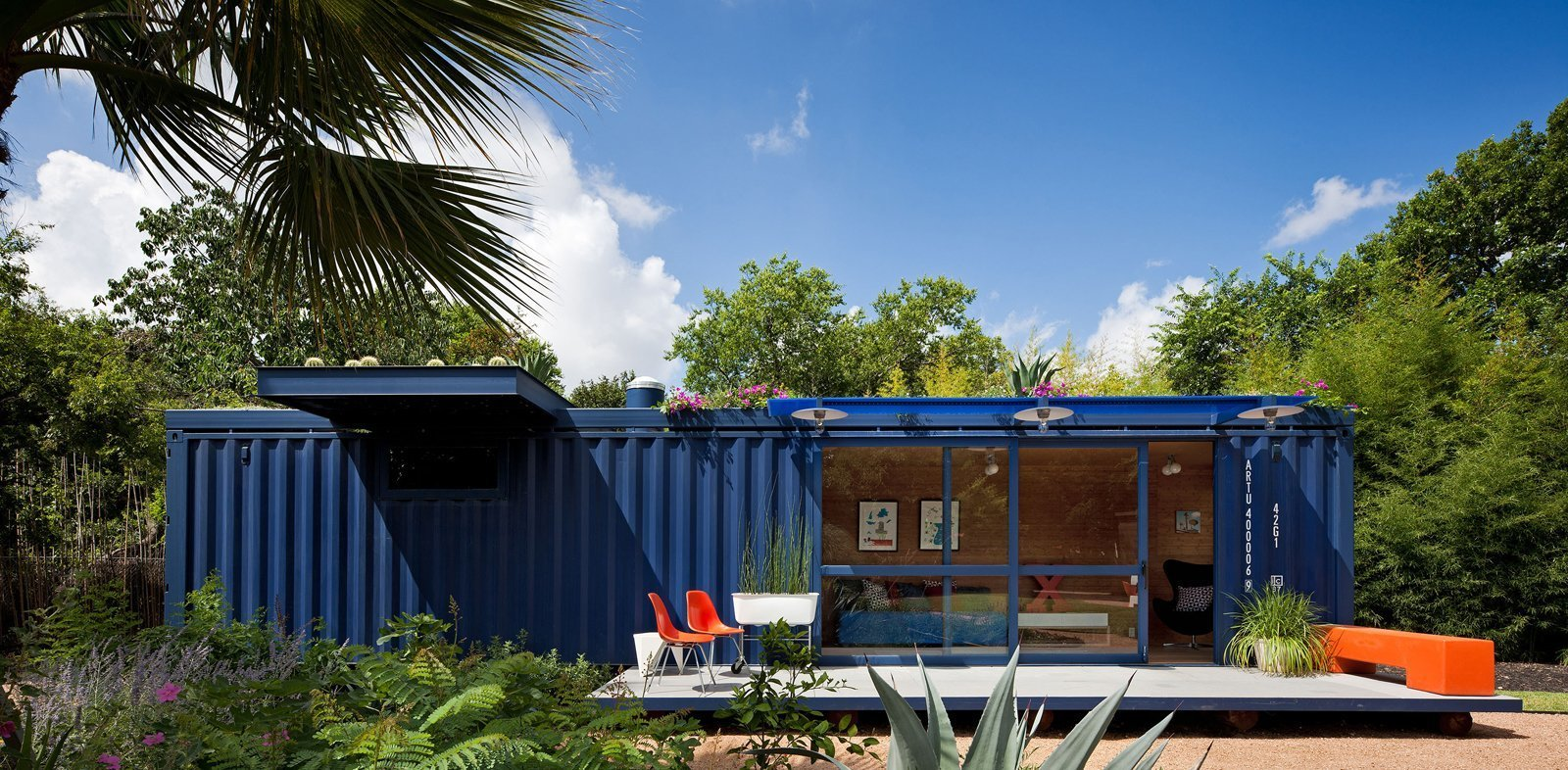 Exterior, Shed Building Type, Metal Siding Material, Shipping Container Building Type, Prefab Building Type, Flat RoofLine, and Metal Roof Material A narrow and long 8 by 40 feet empty steel shipping container in an artists' community in San Antonio, Texas serves a playhouse, garden retreat, and guesthouse for visiting creatives.  Best Photos from 12 Prefab Guesthouses You'll Want to Put in Your Own Backyard