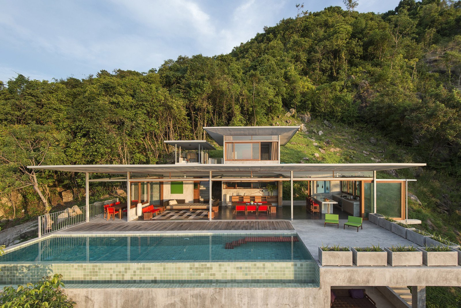 Outdoor and Swimming Pools, Tubs, Shower Set on a green slope, this minimalist, five-level concrete villa designed by architecture and interior photographer Marc Gerritsen connects with its natural surroundings and provides some serious peace and quiet.  Photo 5 of 7 in 6 Modern Pool Villas to Stay at While Visiting Koh Samui, Thailand