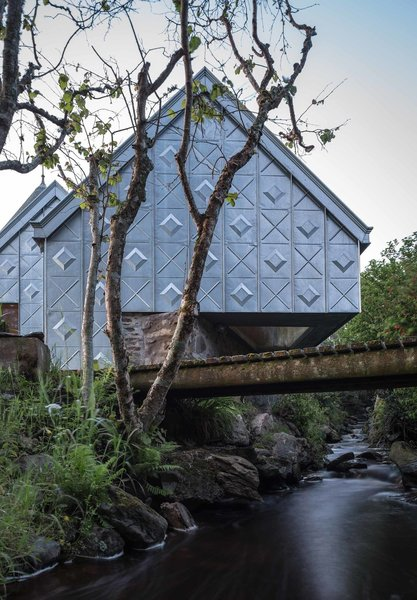 Exterior and Metal Siding Material Futuristic yet traditional, this little holiday retreat prefab in the western coast of Scotland makes a bold statement using just zinc and plywood.  Photo 6 of 8 in 7 Modern Modular and Prefabricated Homes in the UK