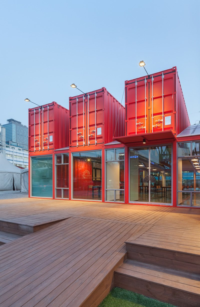 Exterior, Shipping Container Building Type, Metal Siding Material, and Glass Siding Material Bold, red-colored shipping containers were used to create a (12 meter long) visitor area extension for the National Theatres Company of Korea. Designed as a social zone for theatregoers, the space was equipped with internal sliding partition walls that can be opened or closed to allow for flexible use of the interior spaces.  Best Photos from Discover 5 Public Buildings in South Korea Made Out of Shipping Containers