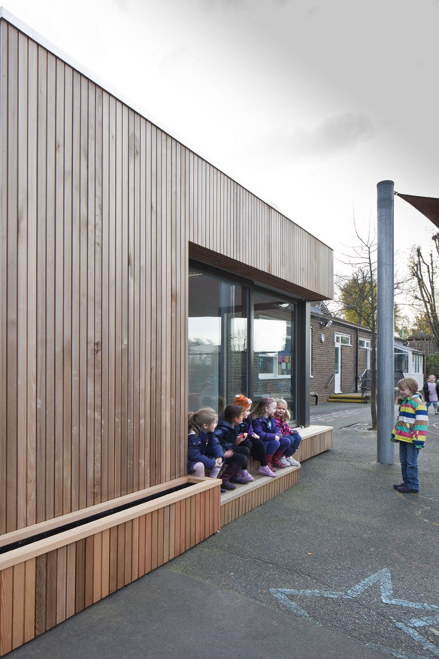Exterior and Wood Siding Material Ecospace classrooms, like this addition to Eleanor Palmer School in London, can address the urgent need for additional music or art classrooms or perhaps a science block, in a warm and bright space.  Photo 6 of 14 in This Company Can Design, Build, and Deliver a Sustainable Prefab in Just 12 Weeks