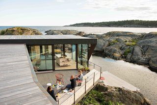 In the Norwegian town of Larvik in Vestfold County, Oslo-based practice Lund Hagem Architects renovated a summer cabin on a rocky terrain with generous outdoor patios that take advantage of dramatic coastal views.