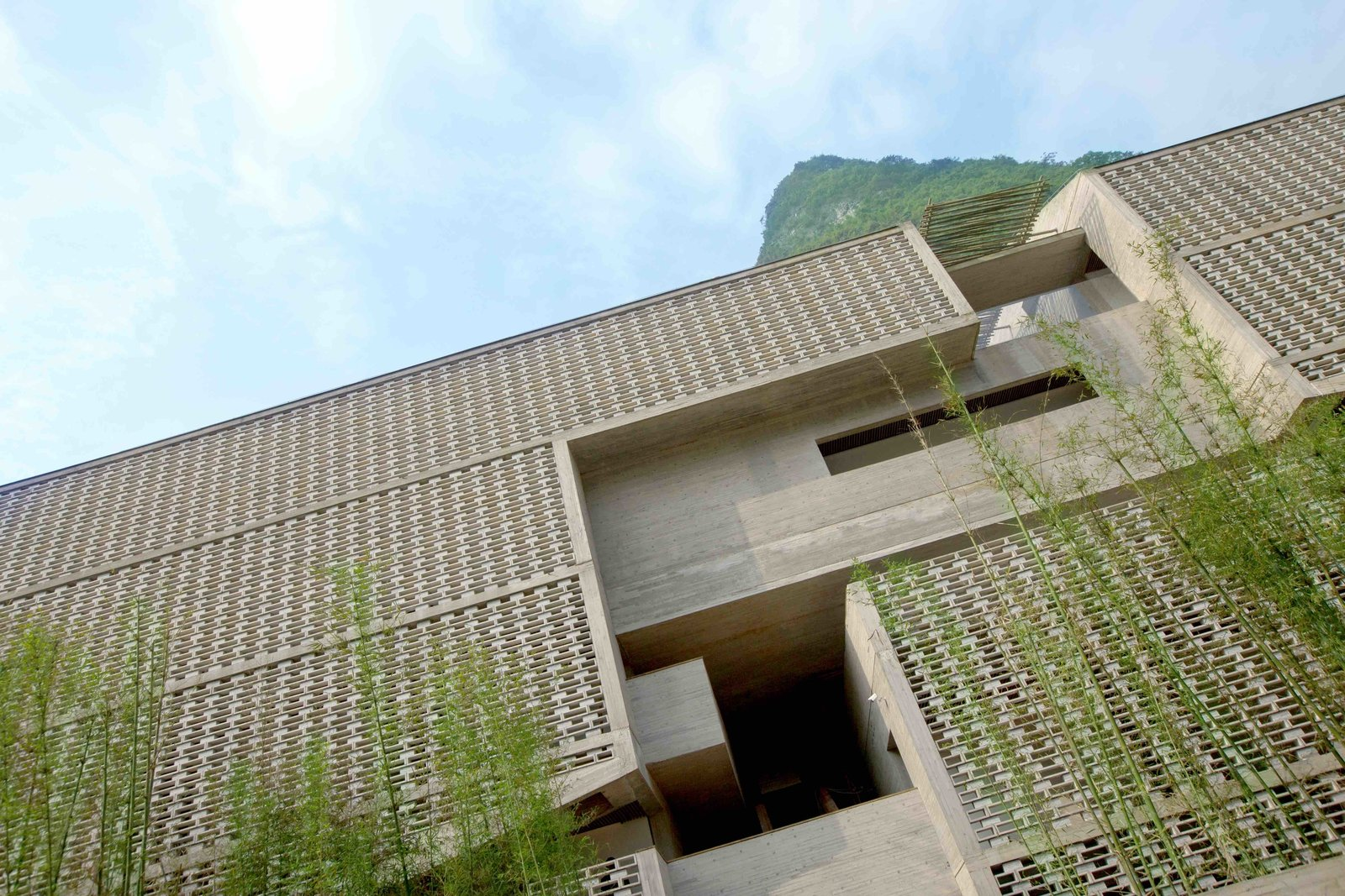 Exterior and Stone Siding Material To create a few new wall sections, founding partner of Vector Architects Dong Gong created hollowed-out brickwork inspired by the sugar blocks produced in China in the 1920s.   Alila Yangshuo from A Chinese Sugar Mill From the 1960s Becomes a Cave-Inspired Hotel