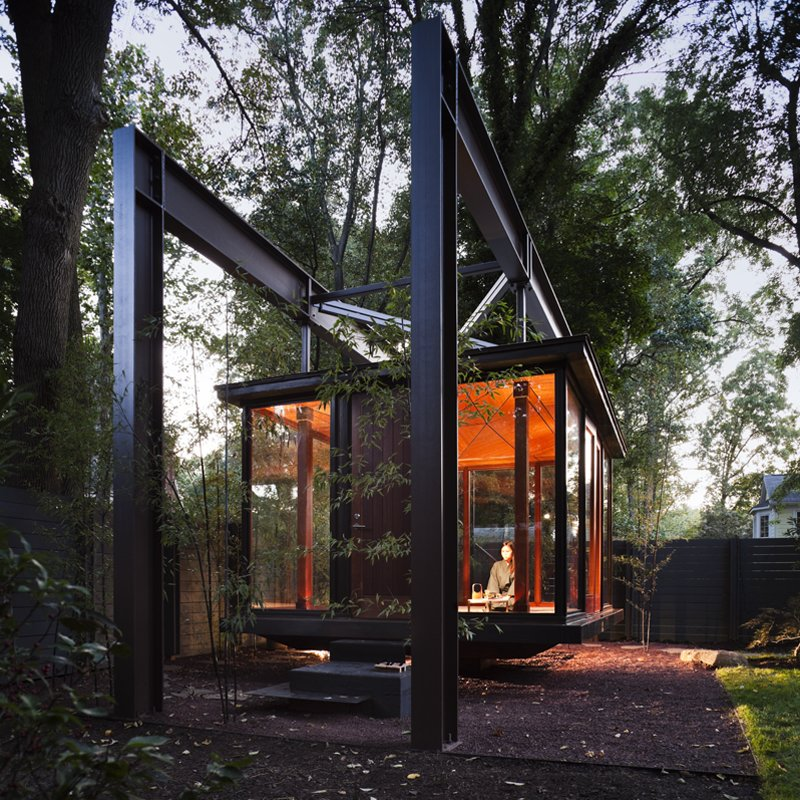 Shed & Studio Suspended in a garden in private residence in the northwest of Washington DC, this bronze and glass building, which is illuminated from the ground up, looks like a Japanese tea pavilion, but is in fact a musical recital space that its owner also use as a room for dining and contemplation.  Photo 10 of 13 in 6 Tiny Outdoor Pavilions Inspired by Japanese Tearooms