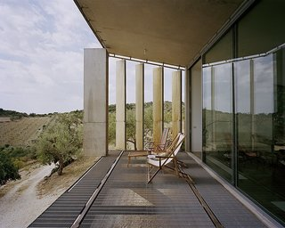 This three-bedroom villa in the commune of Noto in Sicily has a front portion that's raised a few feet off the ground and supported by three concrete structures. It's louvered exterior skin can be closed or opened fully, so guests can enjoy views of the sea from a distance.