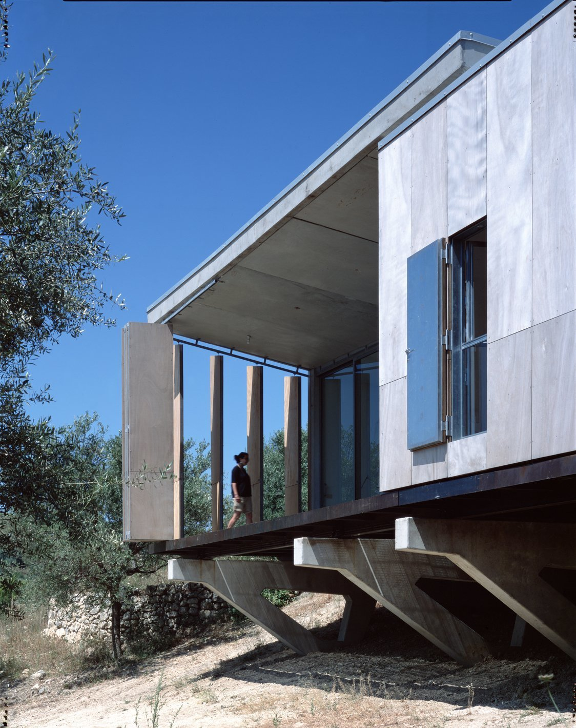 Exterior, House Building Type, Flat RoofLine, and Wood Siding Material Designed by Italian architect Maria Giuseppina Grasso Cannizzo, this holiday villa in the Sicilian countryside is intelligently designed so it's raw wood board louvres can be opened to create a balcony that looks out to the countryside and sea beyond, or closed to maximize interior space.  Photo 10 of 11 in 7 Ways to Make the Most of Your Balcony