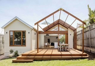 While Edwardian timber homes are common in Sandringham, a beachside suburb in Melbourne, this one features a custom rear extension with two gable roofs that house the master bedroom, kitchen, and dining room. The open plan allows the spaces to flow into the yard, which features a new patio with a timber pergola for open-air dining.