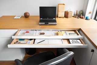Sliding trays help keep paperwork out of sight.