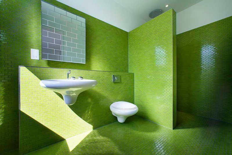 Bath Room, Wall Mount Sink, Ceramic Tile Wall, Ceramic Tile Floor, and Corner Shower When remodelling this five-bedroom family home in an Edwardian building in London, design firm AMA decked the three bathrooms in lime green, baby blue, and lemon yellow tiles  Photos from 8 Bold Bathrooms That Don't Back Away From Color