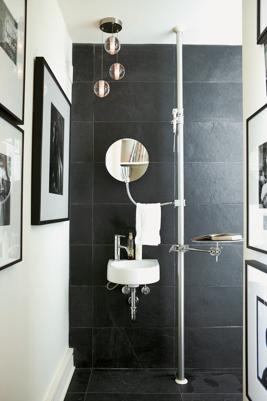 Bath Room, Wall Mount Sink, and Pendant Lighting For guest bathrooms, where only minimal storage systems are needed, why not go light and vertical with a modular floor-mounted Autopole shelf system with a mirror, soap dish, hand towels, and a tray hang by Alu that frees up floor space.  Best Photos from 8 Bathroom Storage Hacks You Probably Haven't Tried Yet