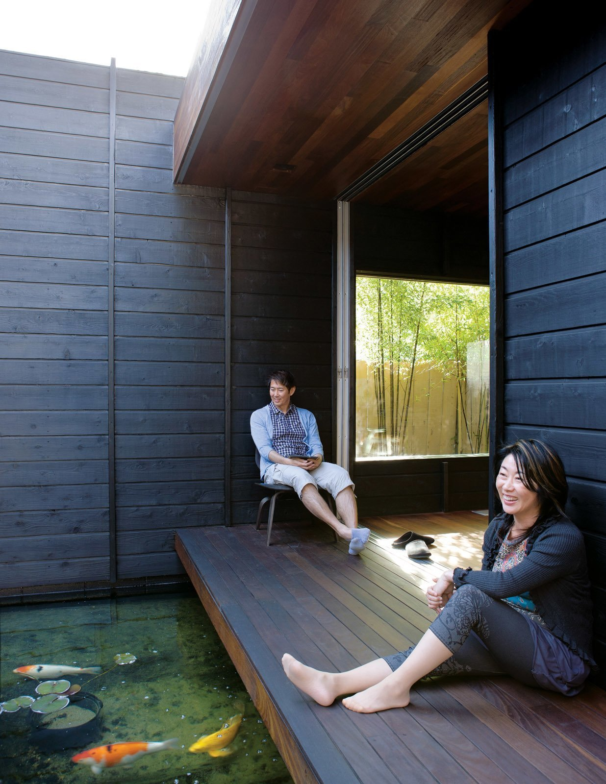 Outdoor, Wood Patio, Porch, Deck, and Side Yard This Southern Californian home by architect Sebastian Mariscal has a wabi-sabi spirit, and is built with shou sugi ban timber, has a koi pond, wand a protective overhang, and a tertiary space known in in traditional Japanese homes as the  Photos from 10 Zen Homes That Champion Japanese Design