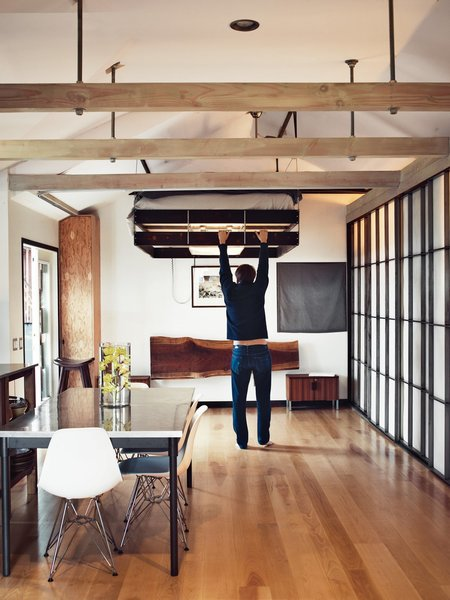 "When redesigning ""Madmen"" actor Vincent Kartheiser's Hollywood cabin, architect Funn Roberts installed custom shoji-style screens of to conceal the closet and provide privacy for the adjacent shower and soaking tub."