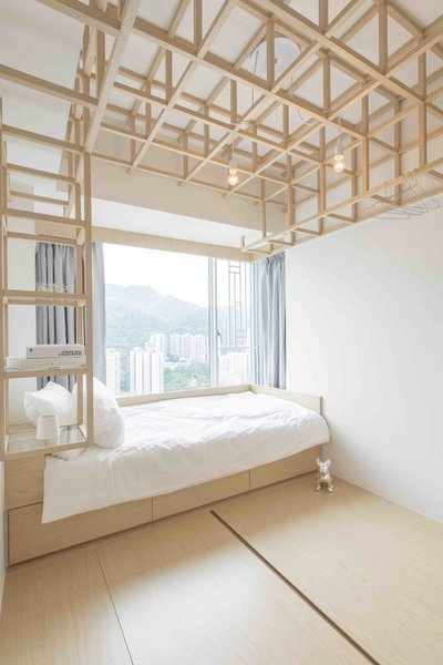 Light wood bedroom with two hanging pendant bulbs within geometric square ceiling fixture