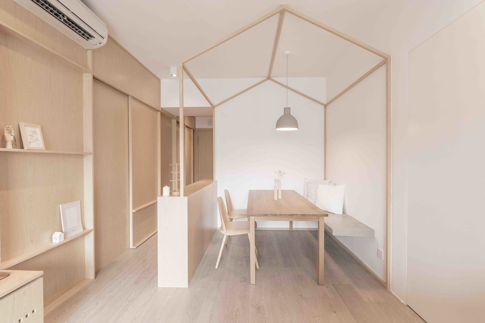 Living Room, Shelves, Ceiling Lighting, Light Hardwood Floor, Pendant Lighting, Bench, Table, and Chair For this 780-square-foot apartment Hong Kong apartment, local practice MNB Design Studio used plywood, smart storage solutions, and tapped into the principles of origami to create a highly structured, minimalist home.  Photo 10 of 21 in 10 Zen Homes That Champion Japanese Design