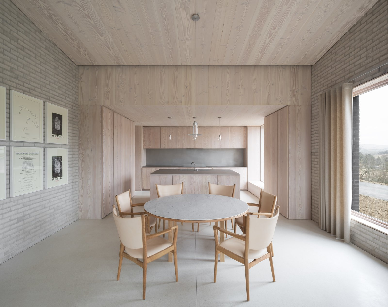Dining Room, Table, Chair, and Pendant Lighting Influenced by both Benedictine monasteries and Japanese residences, award-winning British architect John Pawson created The Life House – a minimalist holiday rental home in Wales with a pure and uncluttered ambience that encourages a state of quietude and contemplation.  Best Photos from 10 Zen Homes That Champion Japanese Design