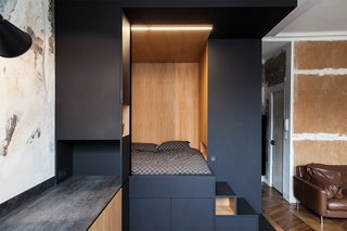 "A ""space cube"", made of Fenix NTM's matte nanotech material combined with warm oak serves as sleeping nook and storage."