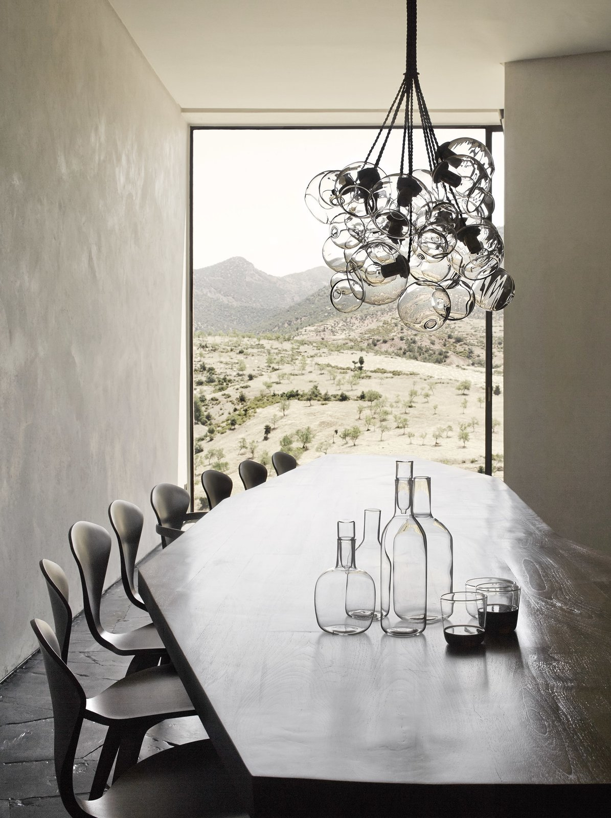 Dining Room, Chair, Pendant Lighting, and Table Yhe light that enters the home has a sundial effect, and pans across the rooms over the course of the day.  Photo 2 of 10 in 4 Enchanting Moroccan Villas by French Duo Studio KO