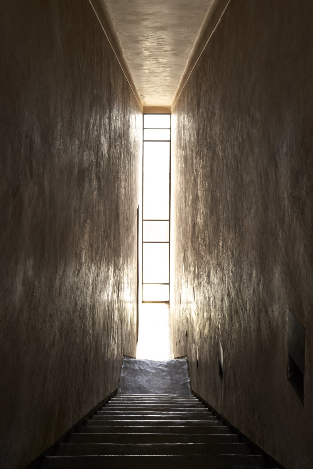 Windows A narrow glass window that cuts through the interiors from floor to ceiling.  Photo 8 of 10 in 4 Enchanting Moroccan Villas by French Duo Studio KO