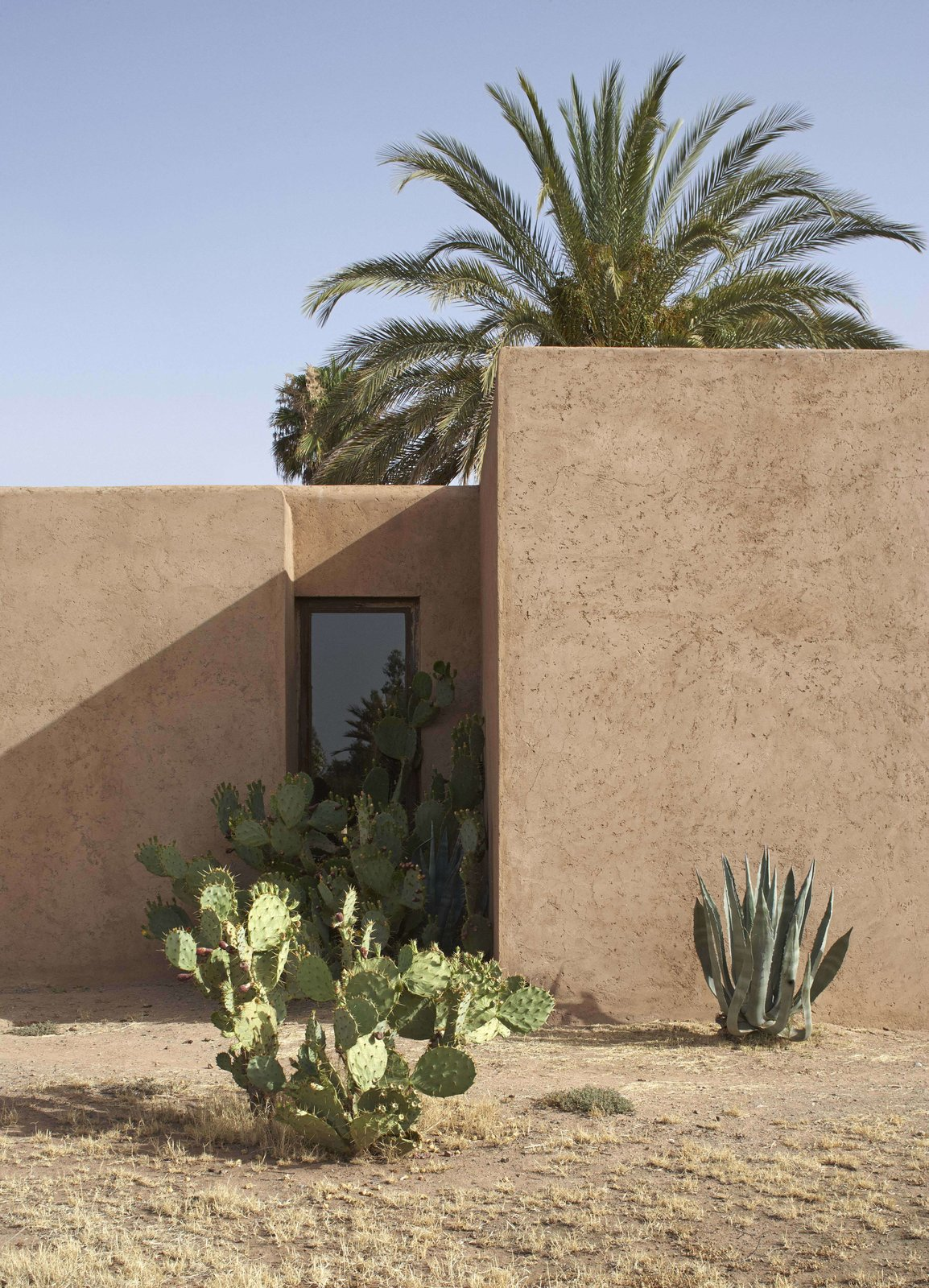 Exterior, Flat RoofLine, and House Building Type Narrow slits and small apertures in place of conventional openings in Villa D.  Photo 9 of 10 in 4 Enchanting Moroccan Villas by French Duo Studio KO